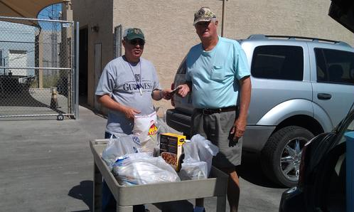 Club president, Alan Friedman, delivers the food and cash donations from the April 20, 2013 Fun Fly